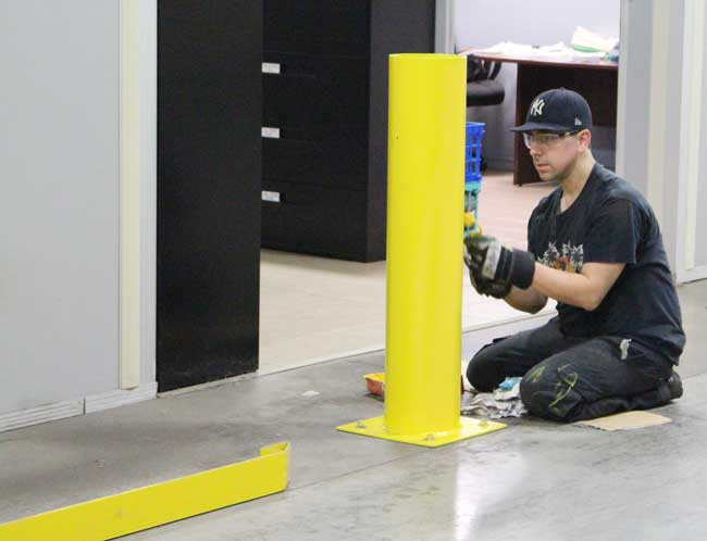 painting safety barriers at Sure Flow